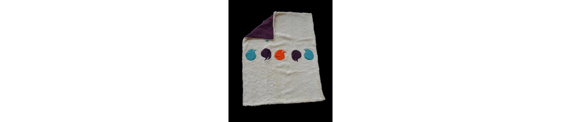 Des couvertures en coton bio, personalisable avec prénom de l'enfant